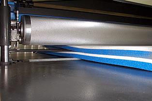 A laminator welder in action