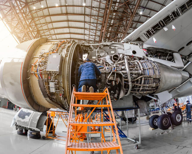 A person working on a jet engine