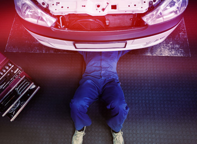 A person underneath a vehicle