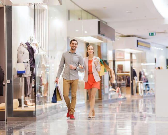A couple walking in a shopping centre