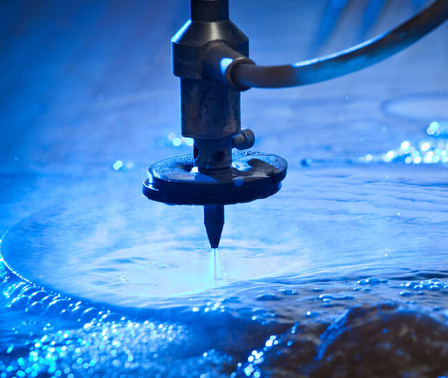 A water jet cutter in action